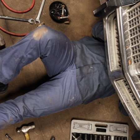 Mechanic Working On A Car