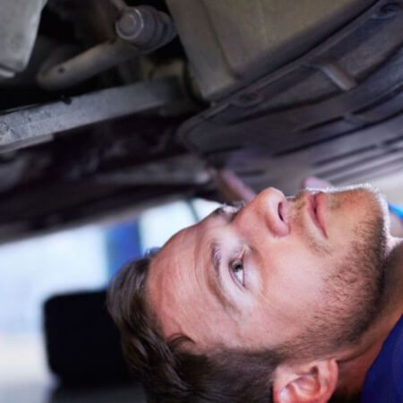 Motor Trade Mechanic Fixing A Car